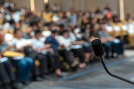 Microphone over blurred conference hall