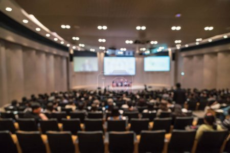 seminar room with speakers on stage