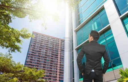 Businessman looking at office buildings
