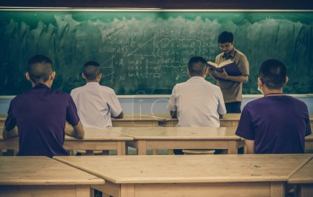 teacher giving lesson to students