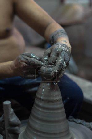 potter creating an earthen jar
