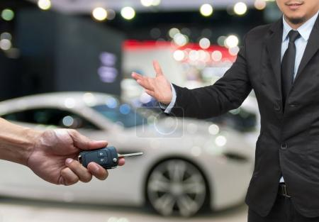 Male hand holding car key