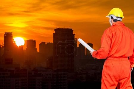 engineer worker holding blueprint