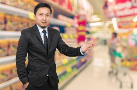 Asian Businessman with welcoming gesture