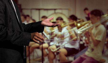 Orchestra conductor hands leading