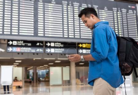 traveler using smartphone for check-in