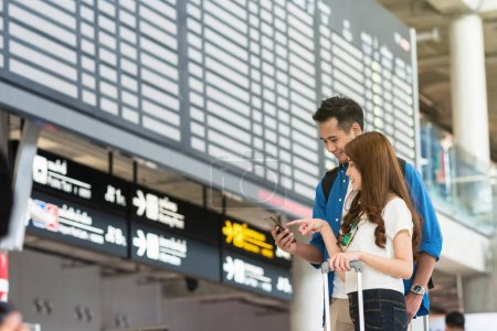 couple using smartphone for check-in
