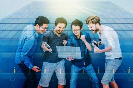 Group Of Multiethnic Business people using laptop