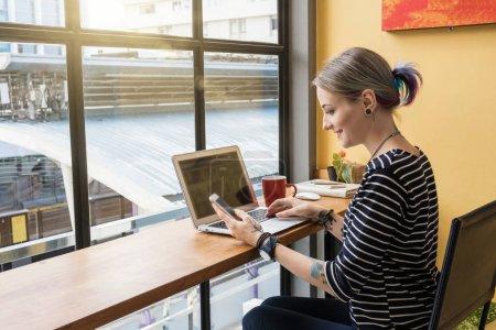 Woman freelancer using laptop