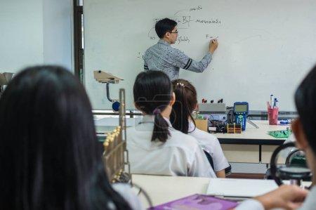 Asian teacher Giving Lesson