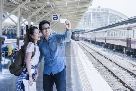 Couple of Multiethnic Travellers taking selfie