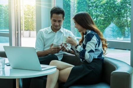 businesswoman and businessman drinking cofee