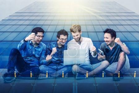 multiexposure of businessmen using laptop