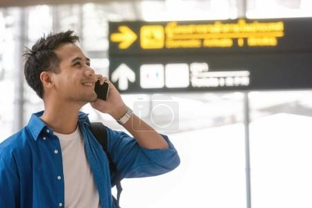 Asian traveler using the smart mobile phone