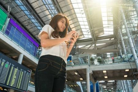 Asian woman traveler using smartphone