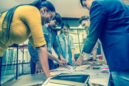 Photo for Group Of Asian and Multiethnic Business people with casual suit working and brainstorming together in the modern Office, people business group concept - Royalty Free Image