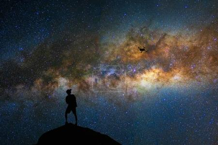 photographer with drone over the milky way