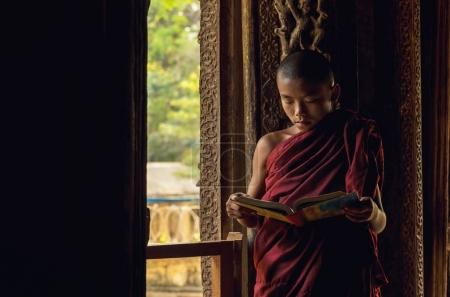 Buddhist novice praying