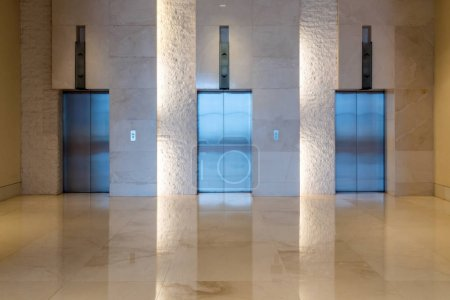 Three elevator doors interior building