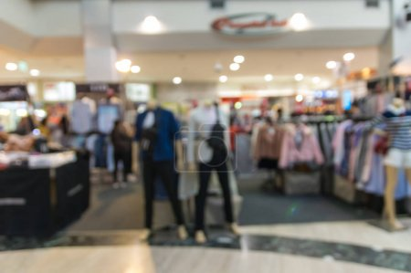 Abstract blurred photo of clothing store in a shopping mall, shopping concept