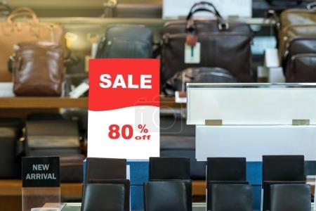 sale 80 off mock up advertise display frame setting over the stack of wallet in the shopping department store for shopping, business fashion and advertisement concept