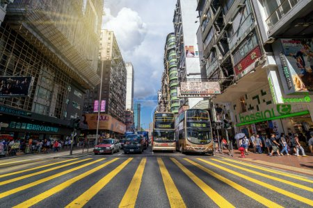 HONGKONG ,CHINA - July 12 : Many Undefiend bus and van stopping at the intersection of walking street around mongkok street for shopping on the July 12, 2017 in Mongkok, Hong kong