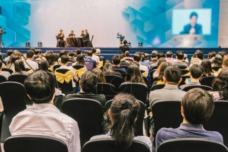 Photo for Speakers on the stage with Rear view of Audience in the conference hall or seminar meeting, business and education about investment concept - Royalty Free Image