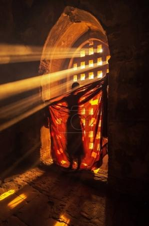 Photo for Back side of monk change the robe with sun ray in pagoda at bagan, mandalay, myanmar - Royalty Free Image