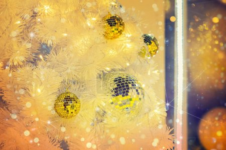 New Year's Eve Christmas tree with ball bauble wintertime decoration, xmas celebration concept