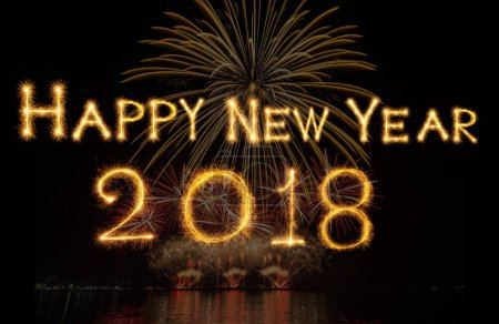 Happy new year 2018 written with Sparkle firework on fireworks with dark background, celebration and greeting cards concept