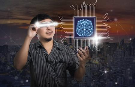 Man wearing smart high tech glasses and looking for the brain ov