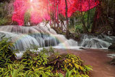 Beautiful waterfall with rainbow in the deep forest, Pha Tat Waterfall, Kanchanaburi province, thailand, Nature travel concept