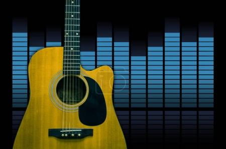 Guitar over the sound waves equalizer background, musical instrument concept