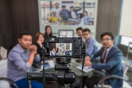 Professional digital Mirrorless camera with microphone recording video blog of Group of asian Business team having video conference,Camera for photographer or Video and Live Streaming concept