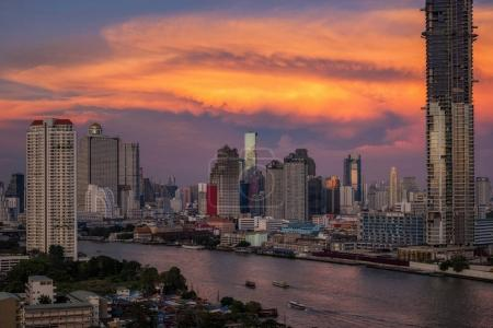 Fantastic scene of Bangkok cityscape river side with amazing beautiful cloud on the sky at twilight time ,Thailand