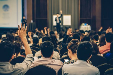 Photo for Speaker on the stage with Rear view of Audience in the conference hall or seminar meeting, business and education concept - Royalty Free Image