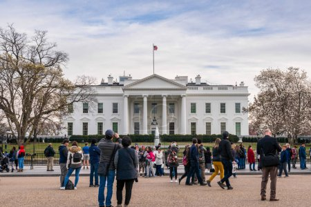 Photo for WASHINGTON DC, USA - MAR 2019 : Unrecognizable various tourists are visiting the The White House of the United States of America on March 20, 2019. Washington DC, USA, official residence and workplace - Royalty Free Image