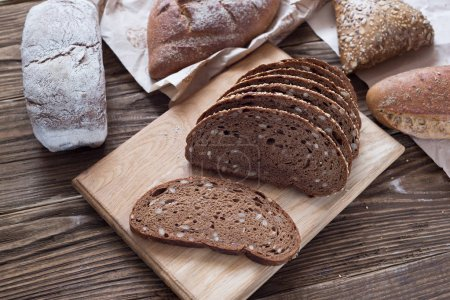 Different bread on table close-up. healthy bread on wooden background, craft paper.