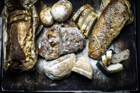 Photo for A high angle shot of different types of bread in a bakery - perfect for a  food blog - Royalty Free Image