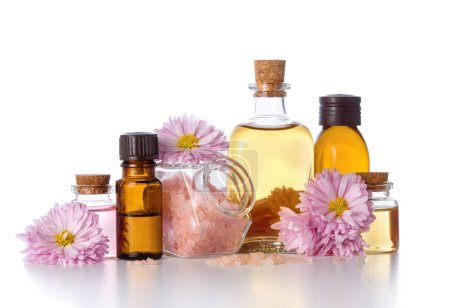 Photo pour Flower pink and yellow water and chrysanthemum essential oil in bottles, bath salt and SPA, isolated on white background - image libre de droit