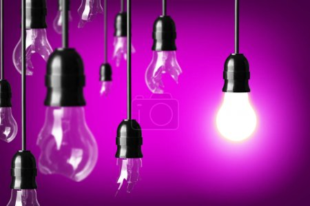 Photo for Idea concept with broken bulbs and one glowing bulb - Royalty Free Image
