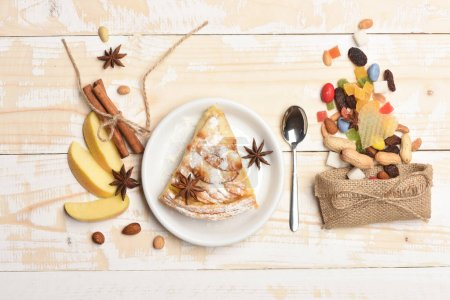 Apple pie and sweets on vintage wooden background