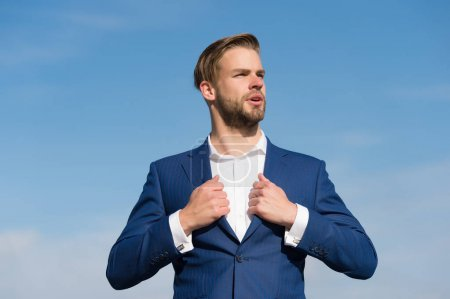 Photo for Businessman stand on blue sky, success. Man in business suit, fashion. Success, ambition, freedom, achievement. Fashion, style, lifestyle. Business, entrepreneurship, career. - Royalty Free Image