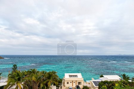 Photo for Villa on tropical sea beach in philipsburg, sint maarten. Beach vacation at Caribbean. Wanderlust, adventure and travel. View of blue sea on cloudy sky, nature. - Royalty Free Image