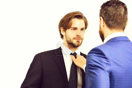 Photo for Businessman attacking his colleague at a meeting, grabbing him by the tie and getting ready to punch him in the face, emotions and feeling - Royalty Free Image