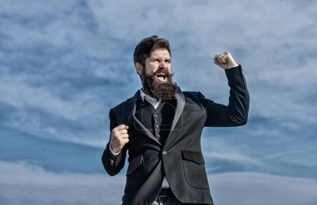 Thankful brutal caucasian hipster with moustache. Mature hipster with beard. Future success. Male formal fashion. Thankful bearded man. Businessman against the sky. Thank you. Thankful for success