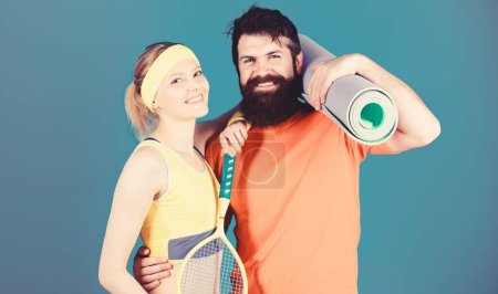 Photo for Sport is our life. Healthy lifestyle concept. Man and woman couple in love with yoga mat and sport equipment. Fitness exercises. Workout and fitness. Girl and guy live healthy life. Fitness exercises. - Royalty Free Image