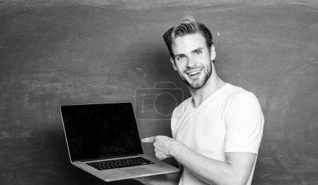 Photo for School teacher programming with laptop. Handsome man use modern technology. Digital technology. Apply online course for programmers. Student learn programming language. Programming web development. - Royalty Free Image