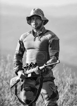 Photo for Hunter hold rifle. Hunter mountains landscape background. Focus and concentration experienced hunter. Ready to shoot. Army forces. Man military clothes with weapon. Brutal warrior. Rifle for hunting. - Royalty Free Image