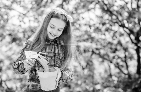 ecology environment. Happy childrens day. little girl with gardening tools. earth day. summer farm. Happy childhood. little girl kid in forest. spring village country. Enjoying her work
